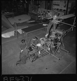 BC Vocational School; Aeronautics students working on a helicopter in the hangar in Burnaby [1 of...