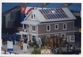 A house with solar panels on the roof displayed at a home and garden show