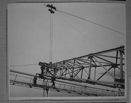 Structural steel; workers assembling a steel structure