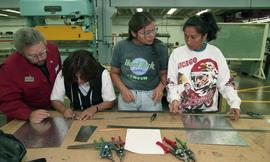 Pre-trade Aboriginal women; sheet metal, students and instructor in class [2 of 12 photographs]