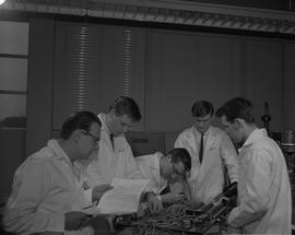 Instrumentation, 1966; five men in lab coats working on a circuit board