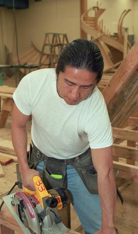 First Nations student wearing a tool belt and using a woodworking tool [4 of 13 photographs]