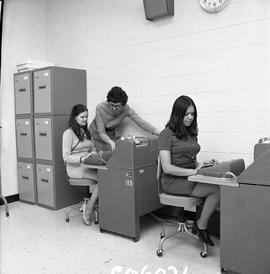 BC Vocational School Commercial Program; two students typing and instructor