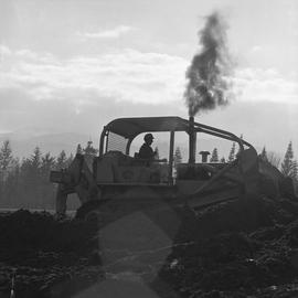 Heavy duty equipment operator, Nanaimo ; man operating a bulldozer moving dirt [9 of 9]