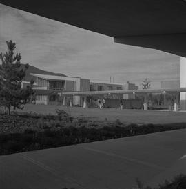 Terrace campus, BCVS, 1971; garden and lawn area, people walking under covered walkway, buildings