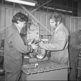 BCVS Heavy duty mechanic program ; a student and an instructor looking at a motor