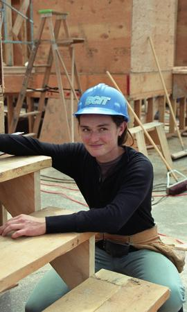 BCIT Women in Trades; carpentry, Kathy Thom, BCIT Faculty, wearing BCIT hardhat next to newly bui...