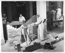 Bricklaying; students building various brick fireplaces in a workshop ; Photo by the Division of ...