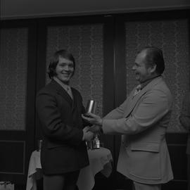 Hockey presentation, Plaza 500, 1972; player receiving an award [2 of 4]