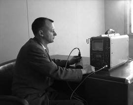 Instrumentation, 1964; man sitting at a desk using an ultrasonic flaw detector [1 of 4]