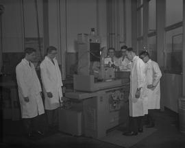 Mechanical Technology, 1966; six men in lab coats using a piece of equipment