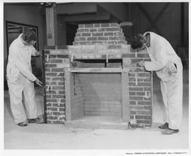 Bricklaying; Two men working on a brick fireplace; Photo by the Division of Vocational Curriculum...
