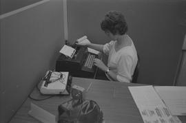 Pacific Vocational Institution ; student sitting at a desk using a typewriter