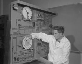 Instrumentation, 1966; a man in a lab coat using circuit testing equipment [2 of 2]