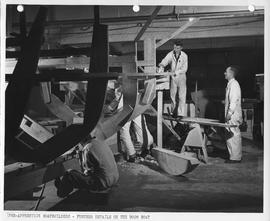 Pre-apprentice boatbuilders working on details of a boom boat; Photo by the Division of Visual Ed...