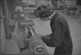 Pacific Vocational Institution ; carpentry student using a wood lathe