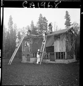 B.C. Vocational School; Carpentry Trades students roofing a small house under construction and st...