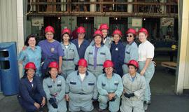 Pre-trade Aboriginal women; gas, group shot of students in uniforms and hard hats during a gas pi...