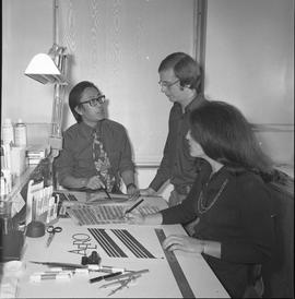 BCVS Graphic arts ; three people at a desk with illustrations