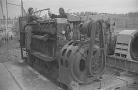 Pacific Vocational Institution ; two men working on large machinery [1 of 4]