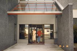 BCIT Broadcast Centre; two women walking through the building entrance