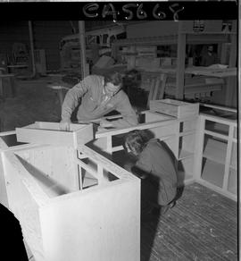 B.C. Vocational School; Carpentry Trades instructor and student with a partially constructed cabi...