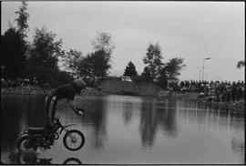 1980 SA Vice President Gordon Sears attempts to jump motorbike across Guichon Creek