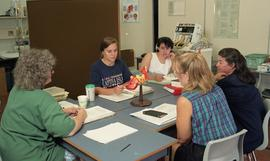C/Care (students in action), 1993, students and nurse working at table [3 of 3 photographs]