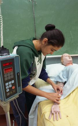 General Nursing, student with dummy patient in bed [4 of 8 photographs]