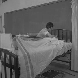 Practical nursing, Nanaimo, 1968; nurse attending to a patient [2 of 2]