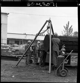 B.C. Vocational School image of Boilermaker students welding pipe with an instructor directing