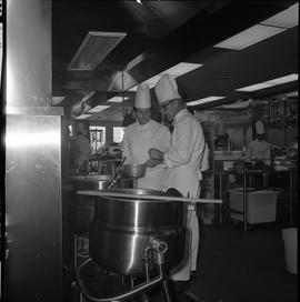 BC Vocational School Cook Training Course ; instructor and student looking in a large pot