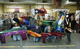 BCIT women in trades; fender, students holding painted car fenders inside a shop [4 of 9 photogra...