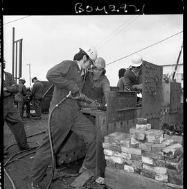 B.C. Vocational School image of Boilermaker students working on metal plates [1 of 2 photographs]