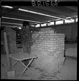 B.C. Vocational School image of Bricklaying student building a brick fireplace in the shop
