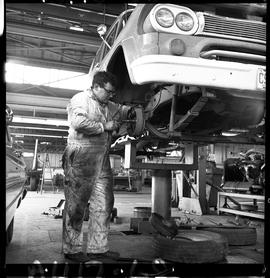 B.C. Vocational School image of an Automotive program student working on a vehicle in the shop.