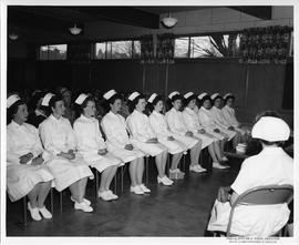 Meeting, with nurses in front row and others behind (ca. 1963)