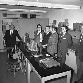 BCIT Programs Forestry Technology ; group of men standing and talking in a classroom [3 of 3]