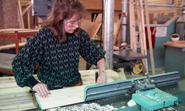 BCIT Women in Trades; carpentry, woman using saw [1 of 2 photographs]