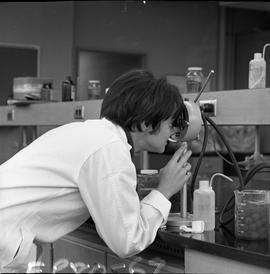 BCIT Food Technology program ; a student looking through a lens ; various food in beakers on the ...