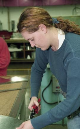 BCIT women in trades; sheet metal, students using tools and equipment on sheet metal inside a sho...