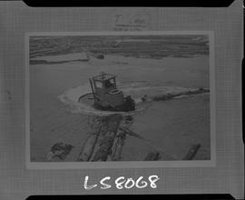 Logging, 1968; copy negative; picture of tug boat in a log pond