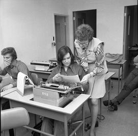 BC Vocational School Commercial Program; instructor checking a student's typewritten work [2 of 2]