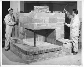 Bricklaying; Two students working on a large brick fireplace; Photo by the Division of Vocational...