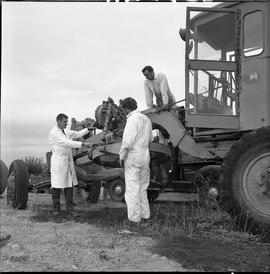 BCVS Heavy duty mechanic program ; two students and an instructor looking at farming equipment
