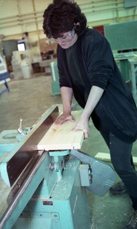 BCIT Women in Trades; carpentry, woman using saw [2 of 2 photographs]