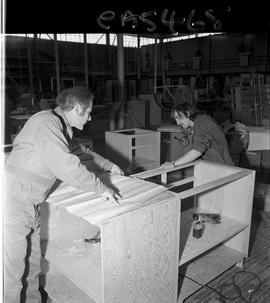 B.C. Vocational School; inside of the Carpentry Trades shop showing an instructor measuring a cab...
