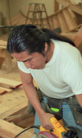 First Nations student wearing a tool belt and using a woodworking tool [5 of 13 photographs]