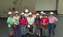 Pre-trade Aboriginal women; students wearing hard hats and tool belts [3 of 8 photographs]