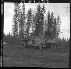 Heavy duty equipment operator, Nanaimo ; man operating a bulldozer dumping dirt into a truck